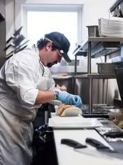 Executive Chef Tyler Sheridan prepares pulled pork