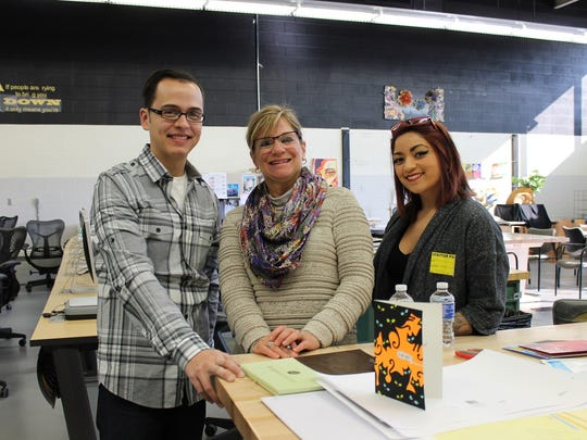 Somerset County Vocational-Technical High School alumni Luis Angulo (left) and Tia Sheridan (right) pose with instructor Linda Weber-Smith (center) during their recent visit to the Bridgewater-based school.