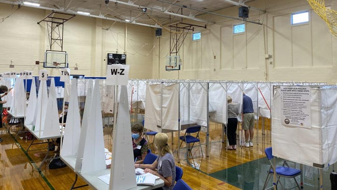 Voters at the polls in Talbot Gym in Exeter Tuesday, Sept. 8, 2020.