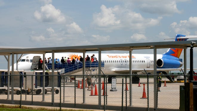 Passengers board Allegiant Air flight from Punta Gorda to Toledo, Ohio.