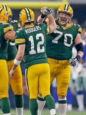 Packers quarterback Aaron Rodgers celebrates a touchdown with guard T.J. Lang.