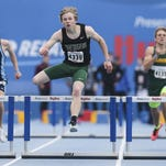 West Burlington Notre Dame's Jacob Smith pulls ahead to win the boys 400 meter hurdles Sat. April 25, 2015 at the Drake Relays in Des Moines, Iowa.