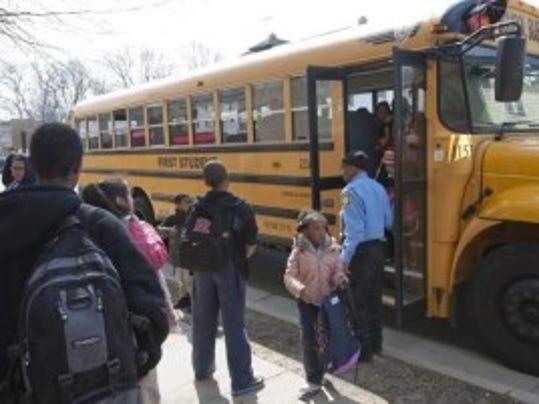 Asbury Park schools students board a school bus after school. Photo by Asbury Park Press staff photographer Bob Bielk.