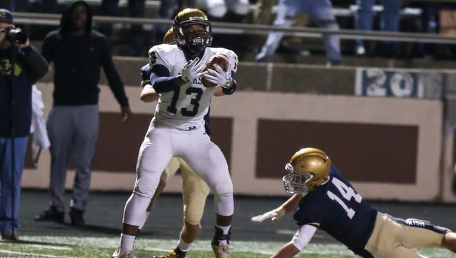 Kenny Tracy (13) has big shoes to fill. His brother, Tyrone, put up big numbers for the Hawks.