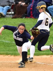 Chambersburg's Dori Loukopoulos, left, stretches to make the out at first base as Alison Shockey of Greencastle-Antrim crosses first base during the Blue Devils' 6-5 win on May 9. Both teams have high seeds for the District 3 playoffs, which begins Tuesday.