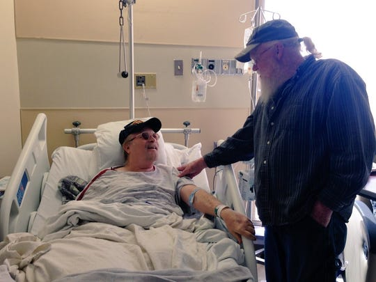 Central Louisiana veteran Larry Tullis (left) talks with his brother and advocate Lavelle Tullis on Oct. 28 between surgeries at Rapides Regional Medical Center.