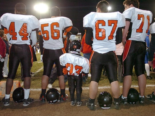 Tucker Haas, then a 6-year-old from Mount Wolf, stands with members of the Central York football team before the Nov. 3, 2006 game at Spring Grove. The squads had a special treat for Haas, who is battling cancer, before the start of the game. The teams lined up for a mock play and allowed Haas to take the handoff and run into the end zone for a touchdown.