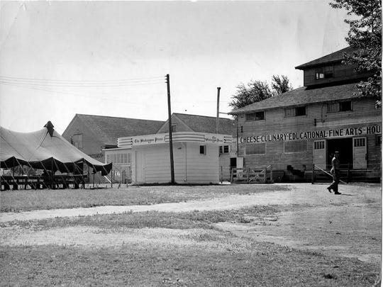 Most of the captives were quartered in the 4-H or education building at the right of the photo at the fairgrounds in Plymouth. The tent in the photo served as an open air mess hall during fair weather.