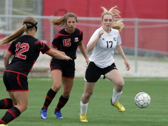 Seymour's Brianna Karweick (12), Elli Ellis (15) chase Belleville/New Glarus' Vanessa Narveson (17) Thursday June 16, 2016 at Uihlein Soccer Park in Milwaukee.