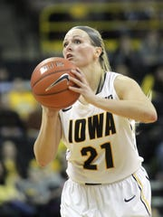 Iowa's Melissa Dixon shoots a 3-pointer during the Hawkeyes' game against Ohio State at Carver-Hawkeye Arena on Thursday, Feb. 5, 2015.
