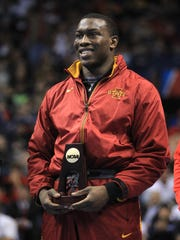 Iowa State's Kyven Gadson accepts his 197 pound NCAA Championship title at the Scottrade Center in St. Louis, Mo. on Saturday, March 21, 2015. Gadson pinned Snyder in 4:24.