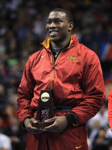 Iowa State's Kyven Gadson accepts his 197 pound NCAA