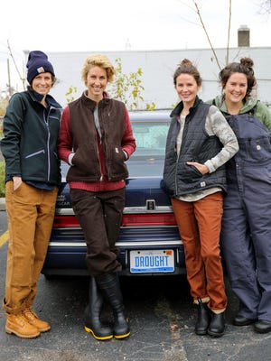 The James sisters pose for a photo wearing gear by Dearborn-based Carhartt in front of the Lincoln Town Car owned by their late grandfather.