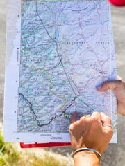 Casey Perkins of the Montana Wilderness Association shows on a map the area around Badger Two-Medicine where oil drilling is proposed.