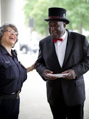 Doorman Christopher Roddy talks with Detroit Transit Police Officer Sharon Lothery last month.