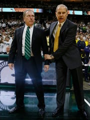 Michigan State basketball coach Tom Izzo, left, and