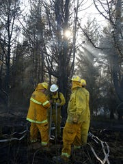 Firefighters battle a blaze on Friday, July 24, 2015, west of Monmouth, Oregon.