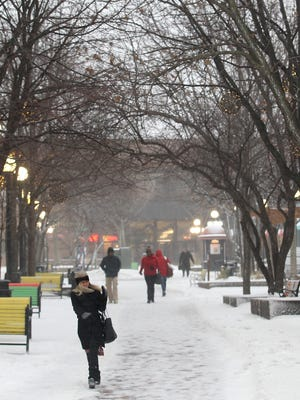 Strong winds blow through the pedestrian mall on Monday, Dec. 28, 2015.