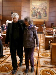 Senators Doug Whitsett and Ginny Burdick walk out of the Senate together following Sine Die to adjourn the 2016 legislative session at the Oregon State Capitol in Salem on Thursday, March 3, 2016.