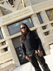 Shaka Senghor outside of the Charles H. Wright Museum.