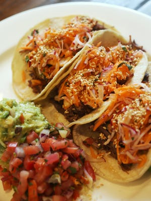 Korean short rib tacos are an example of food truck-inspired dishes on Clustertruck's menu.