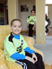 Calder Wills, 11, shown in 2016 with his twin brother,