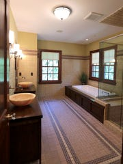 The new master bathroom compliments the Arts and Crafts style of the home.