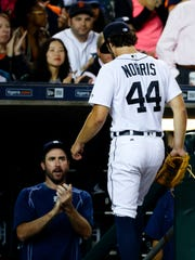 Sep 12, 2016; Detroit, MI, USA; Detroit Tigers starting pitcher Daniel Norris receives applause from Justin Verlander as he walks off the field after being relieved in the seventh inning against the Minnesota Twins at Comerica Park.