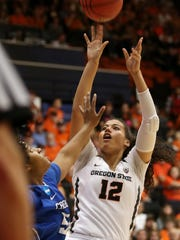 Oregon State's Kolbie Orum (12) shoots the balls past the fingertips of Creighton's Brianna Rollerson (50) in the Creighton vs. Oregon State women's basketball game in the second round of the NCAA Division I Championship in Corvallis, Ore., on Sunday, March 19, 2017.
