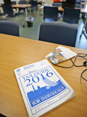 A 2016 tax guide sits on a desk at a free tax preparation site at the John Boner Neighborhood Centers.