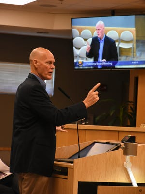 Bob Mulhere, representing Brixmor Property Group, the owner of Town Center, addresses the Marco Island Planning Board on parking issues. The board met Friday morning in the City Council chambers.