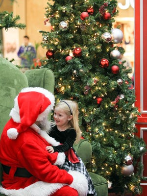 Naomi Wadsworth, 4, of Kalona chats with Santa at the Coral Ridge Mall on Wednesday, Dec. 23, 2015, in Coralville, Iowa.