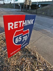 A Rethink 65/70 sign is seen on Davidson St. across