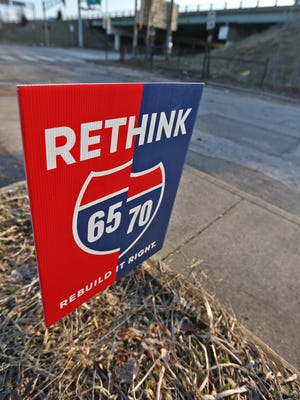 A Rethink 65/70 sign is seen on Davidson St. across from the highway, Tuesday, March 13, 2018.