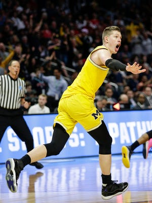 Michigan forward Moritz Wagner (13) celebrates after the dunk against Texas A&M during second half of U-M's 99-72 win over Texas A&M in the Sweet 16 of the NCAA tournament in Los Angeles on Thursday, March 22, 2018.