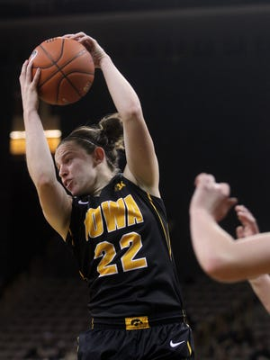 Iowa's Samantha Logic pulls in a rebound during the Hawkeyes' game against Iowa State at Carver-Hawkeye Arena on Dec. 11. Logic is tied with Bethany Doolittle for the team lead in rebounding at 6.8 rebounds per game.