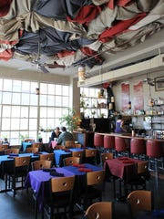 Devotay's updated interior include new flooring, chairs,