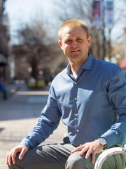 Nate Kaeding poses for a photo on Wednesday, April 1, 2015. Kaeding will graduate from the University of Iowa's Tippe College of Business in May and was recently named the Iowa City Downtown District's retail development coordinator.