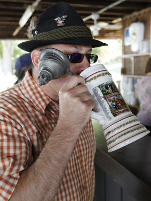 Kevin Sari was using a beer stein he bought in Germany at the 40th Germania Society Oktoberfest.