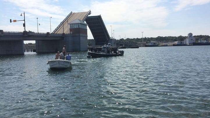 Police and fire rescue boats search for a vehicle that