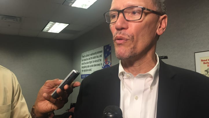 Democratic National Committee chairman Tom Perez talks with reporters in Warren Friday.