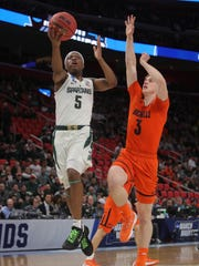 Michigan State guard Cassius Winston scores against Bucknell guard Jimmy Sotos during the first of the NCAA tournament Friday, March 16, 2018 at Little Caesars Arena.