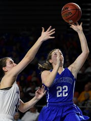 Summertown guard Kaley Campbell (22) shoots past Unaka's Myah Parlier (42) during the first half of their semifinal game in the TSSAA Division I Class A Girls BlueCross Basketball Championships at Murphy Center Friday, March 9, 2018 in Murfreesboro, Tenn.