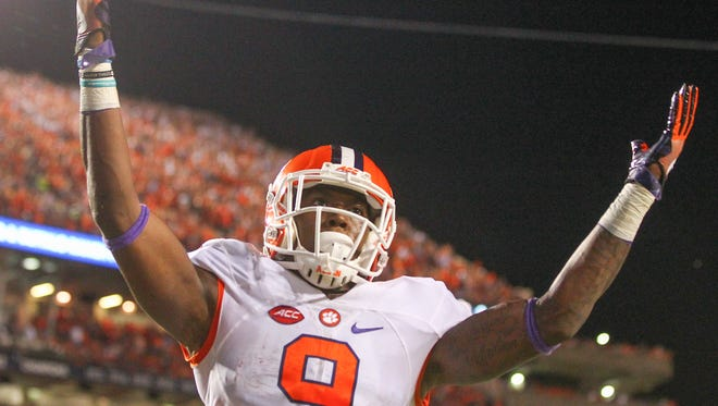 Clemson running back Wayne Gallman (9) celebrates after scoring a touchdown againt Auburn in the second quarter at Jordan-Hare Stadium in Auburn, Alabama.