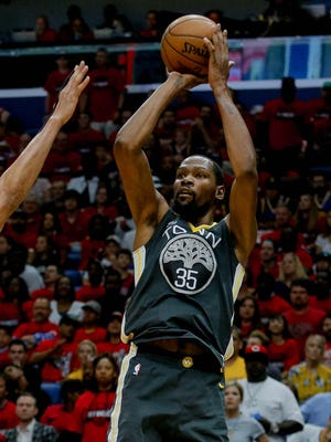 Golden State Warriors forward Kevin Durant shoots over New Orleans Pelicans forward Anthony Davis during the second quarter of Game 4.