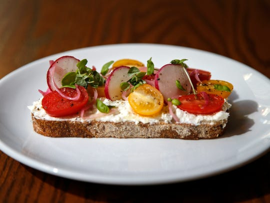 Whipped goat cheese and ricotta toast, cherry tomato,