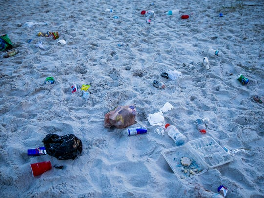 Trash along the beach following the fireworks show