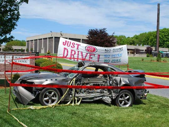 IMPAACT will place displays of wrecked cars in front