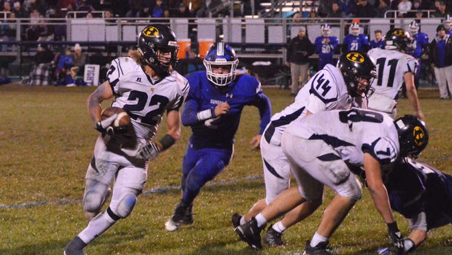 Hillsdale's Zach Kornak (22) runs the ball during a Division 6 regular-season game against Dundee on Oct. 25, 2019. The Hornets will begin training for the upcoming season on June 15, after the Michigan High School Athletic Association handed down updated guidelines allowing outdoor summer activities to resume with social distancing. Sam Fry/Daily News
