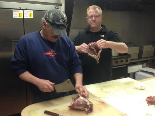 From left, Kevin Murphy and Joe VanSlambrouck prepare